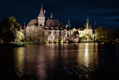 Night view of Vajdahunyad castle from lakeside Stock Image