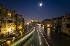 Night View of Venice with Blurred Motion of Boats Stock Photos