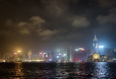 Night view of Victoria harbor and skyscrapers in Hong Kong  Stock Photography
