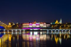 Old town in Warsaw at night. Night view from the Vistula river to the old city in Warsaw royalty free stock photos