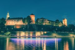 Night view of the Vistula River and Wawel Castle in the Polish city of Krakow. Toned royalty free stock image
