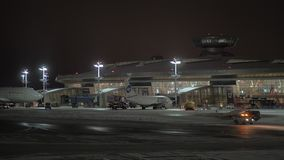 Night view of Vnukovo Airport with Utair and Rossiya airplanes. Moscow, Russia stock footage