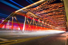 Night view of white ferry bridge outside Shanghai stock images