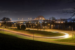 Night view of a winding road leading to a bridge Stock Photography