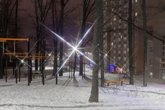 Night view of winter park near of multistory housing estate royalty free stock photos