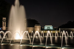 Night view of World War II Memorial with Lincoln. Night view of fountains at the World War II Memorial with the Lincoln Memorial in the back. In Washington DC Royalty Free Stock Photography
