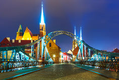 Night view of Wroclaw, Poland. Scenic summer night view of the Old Town illuminated pier architecture and bridge in Wroclaw, Poland Royalty Free Stock Photo