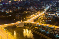 Night view of Y character bridge at Ho Chi Minh Riverside with Ben Nghe or Tau Hu canal Royalty Free Stock Photography