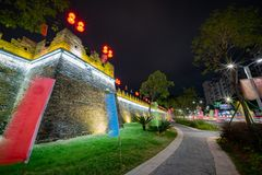Night view of the Zhaoqing Ancient City Wall with Pi Yun Lou building. At China royalty free stock images