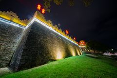 Night view of the Zhaoqing Ancient City Wall with Pi Yun Lou building. At China stock images