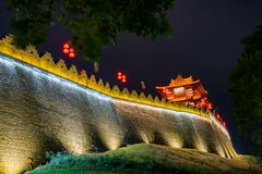 Night view of the Zhaoqing Ancient City Wall with Pi Yun Lou building. At China stock photos