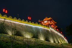 Night view of the Zhaoqing Ancient City Wall with Pi Yun Lou building. At China royalty free stock photo