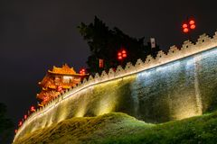 Night view of the Zhaoqing Ancient City Wall with Pi Yun Lou building. At China stock image