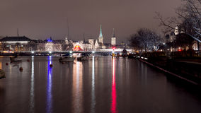 A night view of Zurich with lake and typical church Royalty Free Stock Image
