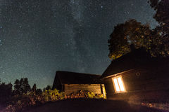 Night village house. Stars in the sky. Royalty Free Stock Images