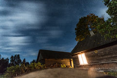 Night village house. Stars in the sky. Stock Image