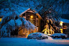 Night village under heavy snow storm stock images