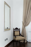 Night Vintage Classic Wooden Chair in Corner and Mirror. In a Modern Bedroom Royalty Free Stock Image