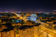 Night Voronezh aerial cityscape from rooftop. Modern buildings in Moscow prospect.  Royalty Free Stock Images
