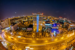 Night Voronezh cityscape from rooftop. Panorama of Leninskiy Prospect. Glass business center Stock Images