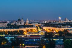 Night Voronezh downtown. View to Voronezh railway station, South-eastern railway main building and Annunciation Cathedral royalty free stock photos