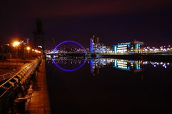 Night walk. An evening stroll through Glasgow at the bank of the canal Royalty Free Stock Images