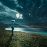 Night walk in the moonlight with a flashlight Royalty Free Stock Photography