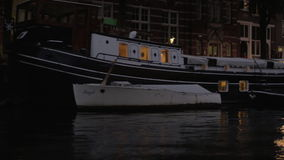 Night water travel on Amsterdam channels stock footage
