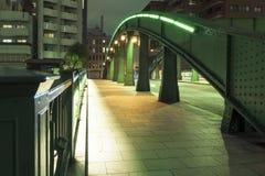 Night way. Illuminated urban way with metallic arc structure Royalty Free Stock Photography