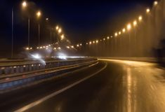 wet highway on the turn Royalty Free Stock Photo