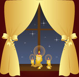 Night Window. A beautiful night view outside the window, bright stars and candles on the windowsill Royalty Free Stock Photo