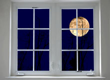Night window. With full moon view