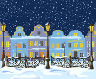 Night winter city with lanterns Royalty Free Stock Photography