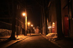 Night winter city streetlights. Night winter city street lights outdoor background Royalty Free Stock Images