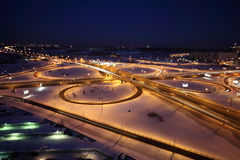 Night winter cityscape with big interchange. Lighting columns and garages, dark blue sky Royalty Free Stock Photography