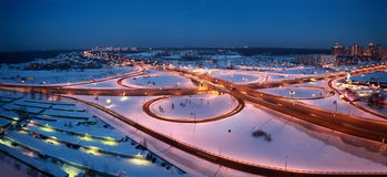 Night winter cityscape with big interchange. Lighting columns and garages, panorama Stock Photography