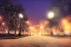 Night winter landscape. In the alley of city park Stock Photo