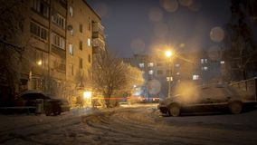 Night winter landscape in the alley of city street. Background stock image