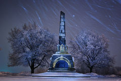 Night winter landscape in the city. Starfall Stock Image