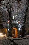 Night winter Lviv city, Ukraine, well in the courtyard of Bernar Stock Photo