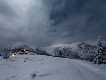 Night winter mountain landscape with house. Stock Photos