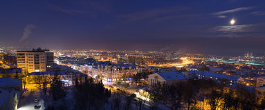 Night winter panorama of a city in a full moon Royalty Free Stock Image