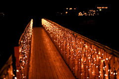 Night wooden bridge with a garland Stock Photos
