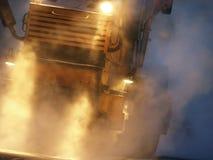 Night work. Asphalt paving machine, working at night Royalty Free Stock Photos