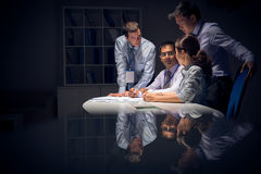 Night work. Copy-spaced image of a modern business team working in the night before deadline stock photography