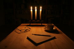 Night writing. Writing the letter near the candlelight royalty free stock image