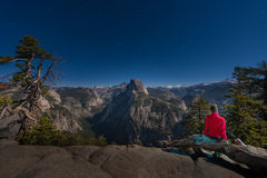 Night in Yosemite Girl looking at Half dome from the Glacier Poi. Woman looking at Half Dome Bright Starry Night Yosemite NP California Royalty Free Stock Image