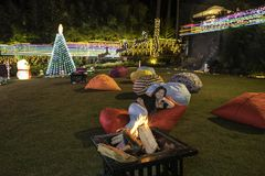 Nightby the campfire in a hotel garden with big beanbags Stock Photography