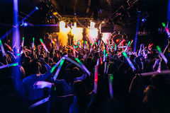 Nightclub crowd dancing. People dancing in nightclub with confetti and other stuff Stock Images