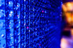 Crystal wall in a nightclub. In a nightclub a crystal blue wall Stock Photo